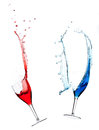 Splashing red and blue wine Royalty Free Stock Images