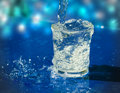 Splashing water from glass Royalty Free Stock Photos
