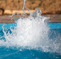 Splashing water in the pool as a background Royalty Free Stock Photo