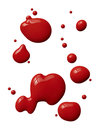 Splattered red paint isolated on white background Royalty Free Stock Image