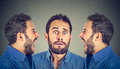 Split personality. Two angry men screaming at scared himself Royalty Free Stock Photo