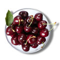 Splody cherries in bowl close up isolated on white. Top view square Royalty Free Stock Photo