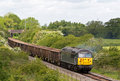 Spoil train calvert uk june a dcr operated class loco hauls an empty to london on june in calvert dcr is a small uk rail freight Stock Image