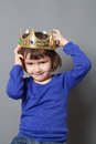 Spoiled kid concept for year old child with crooked golden crown on lovely putting a head mollycoddled little king or queen Stock Photography