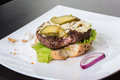 Spoiled tasteless burger with roasted not cutlets old Royalty Free Stock Photos