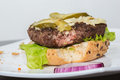 Spoiled tasteless burger with roasted not cutlets old Royalty Free Stock Photography