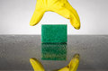 Sponge and glove image of a yellow rubber reaching for a cleaning Royalty Free Stock Image