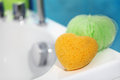 Sponges in the bathroom interior decor Royalty Free Stock Photo