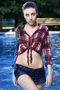 Spontaneous dip in the pool young beautiful lady stepping out of with dripping clothes Royalty Free Stock Photos
