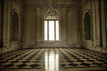 Spooky baroque style room with window, sunbeam and terracotta fl