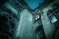 Spooky dark castle house hallowen. Bottom view with bright windo