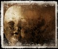 Spooky doll photograph a and disturbing image of a on a grunge and old photo effect Royalty Free Stock Photography