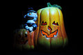 Spooky halloween decoration pumpkin over black Royalty Free Stock Photos