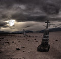 Spooky Halloween graveyard with dark clouds Royalty Free Stock Photo