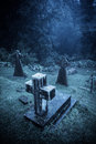 Spooky Halloween graveyard in fog Royalty Free Stock Photo