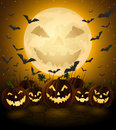Spooky halloween night jack o lanterns with background Stock Images