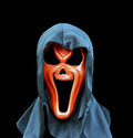 Spooky mask over black background isolated a Stock Photography