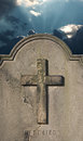 Spooky old cemetery headstone against stormy atmospheric sky weathered Stock Images