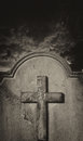 Spooky old cemetery headstone against stormy atmospheric sky weathered Stock Photography