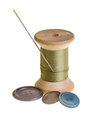 Spool of green thread with needle Stock Photography