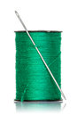 Spool of green thread with needle isolated on white background Stock Images
