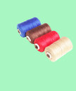 Spool of thread by color singer Stock Photos
