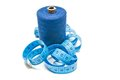 Spool of thread and meter on white Royalty Free Stock Images