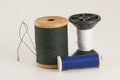 Spool of thread with needle Royalty Free Stock Images