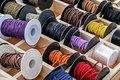 Spools with chains and colored ribbons for made trinkets Royalty Free Stock Photos