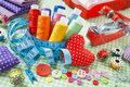 Spools of colorful thread, buttons, fabrics, measuring tape, pin Royalty Free Stock Photo