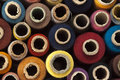 Spools of thread many with different colours Royalty Free Stock Images