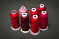 Spools of thread red color Royalty Free Stock Images