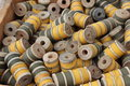 Spools of thread wooden gold and olive drab in a box Royalty Free Stock Photo