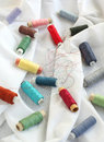 Spools of threads on a cotton fabric Royalty Free Stock Photo