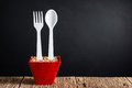 Spoon and fork in flower pot Royalty Free Stock Photo