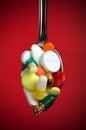 Spoon full of various pills Royalty Free Stock Photo