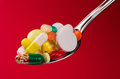 Spoon full of various pills Stock Photos