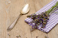 Spoon and lavender on a wooden table napkin Royalty Free Stock Image
