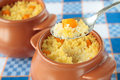 Spoon of millet porridge with pumpkin pot and Stock Photo