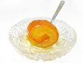Spoon orange sweet traditional greek on small crystal plate with Stock Photography