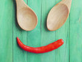 Spoon and Red chili peppers in smile Royalty Free Stock Photo