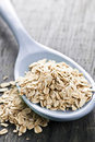 Spoon of uncooked rolled oats Stock Photo