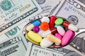 Spoonful of Pills Surrounded by Money Royalty Free Stock Photo