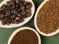 Spoonfuls of Instant Granulated and Roast Coffee Beans Royalty Free Stock Photo