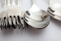 Spoons and forks close up Royalty Free Stock Photos