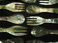 Spoons and forks made from mother of pearl Royalty Free Stock Photo