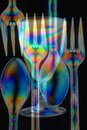 Spoons forks partybeaker consisting transparent plastic seen polarized light composed together Royalty Free Stock Photos