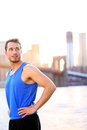 Sport athlete looking resting in new york city after running and training fitness workout outdoor with brooklyn bridge Stock Photos