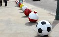 Sport ball icons row of huge sports balls including a basketball a soccer a tennis a golf a fishing bobber and a all white soccer Stock Images