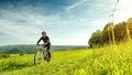 Sport bike woman in a beautiful meadow fabulous scenery Royalty Free Stock Photo